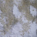 White And Gold Lace Fabric