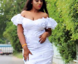 white off the shoulder dress in ghana